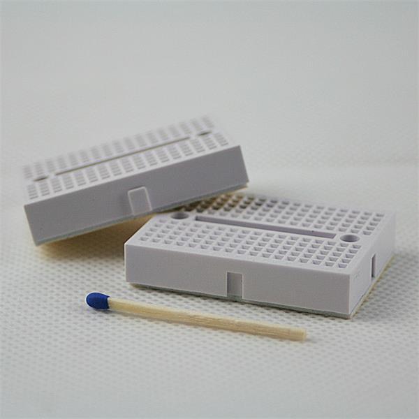 Platine für lötfreien Aufbau elektrischer und elektronischer Schaltungen