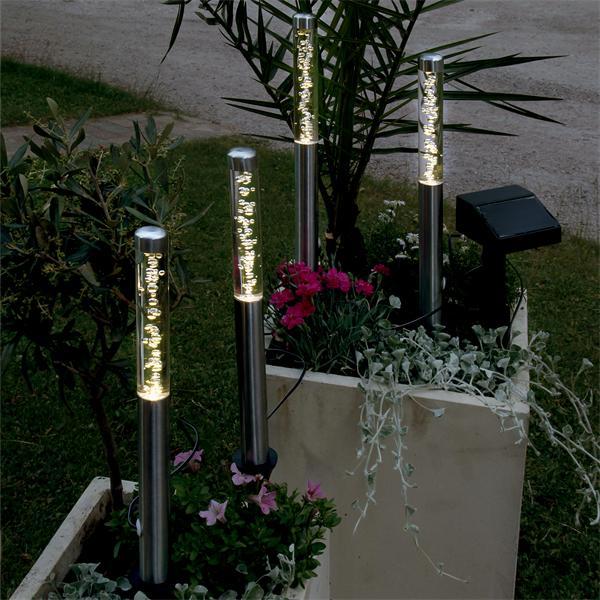 4 Leuchtstäbe mit aufsteigenden Bläschen