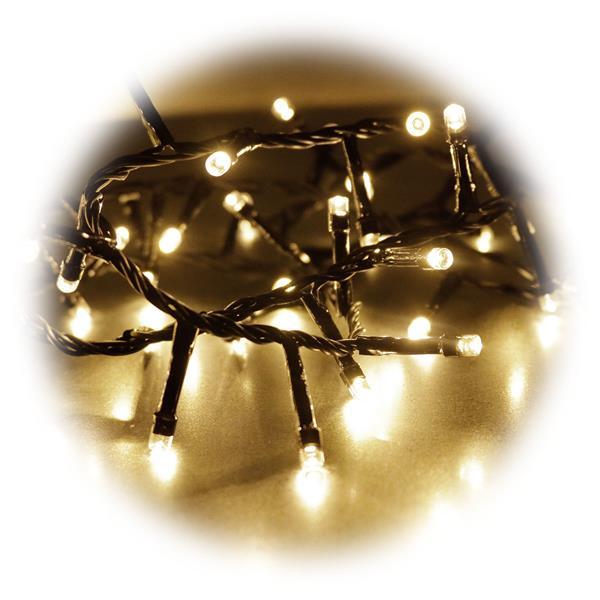golden weißer Lichtschein lässt Bäume, Büsche oder Hausfassaden erstrahlen
